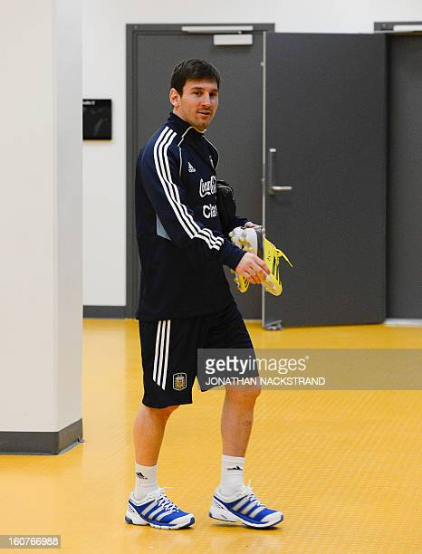Argentina's forward Lionel Messi arrives to the 'Friends Arena' in Stockholm Sweden on February 5 2013 on the eve of the FIFA World Cup 2014 friendly...