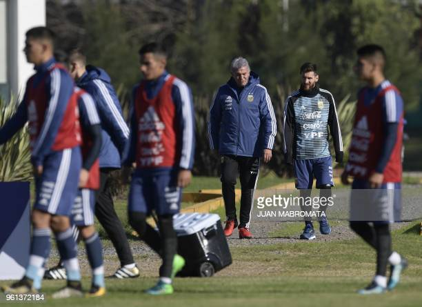 Argentina's forward Lionel Messi arrives with team mannager Jorge Burruchaga to a training session in Ezeiza Buenos Aires on May 22 2018 The...