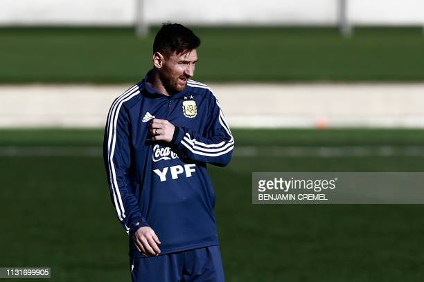 Argentina's forward Lionel Messi attends a training session at Real Madrid's training facilities of Valdebebas in Madrid on March 20 ahead of an...