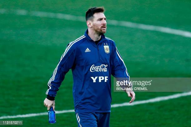 Argentina's forward Lionel Messi attends a training session at the Real Madrid's training facilities of Valdebebas in Madrid on March 19 ahead of the...