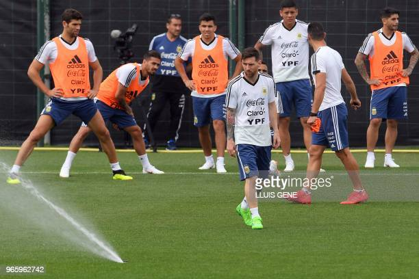 Argentina's forward Lionel Messi attends a training session with teammates at the FC Barcelona 'Joan Gamper' sports centre in Sant Joan Despi near...