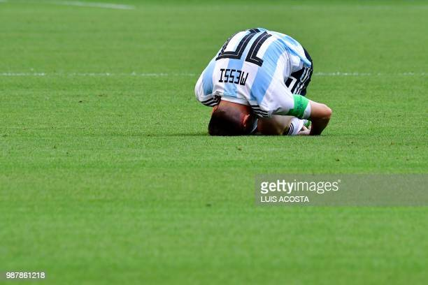 TOPSHOT Argentina's forward Lionel Messi bends on the field during the Russia 2018 World Cup round of 16 football match between France and Argentina...