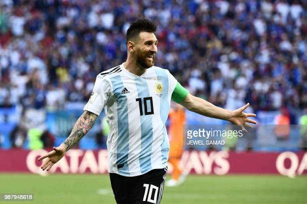 TOPSHOT Argentina's forward Lionel Messi celebrates after his team scored a second goal during the Russia 2018 World Cup round of 16 football match...