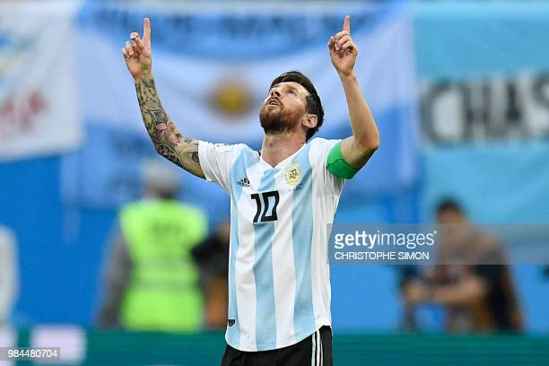 TOPSHOT Argentina's forward Lionel Messi celebrates after opening the scoring during the Russia 2018 World Cup Group D football match between Nigeria...
