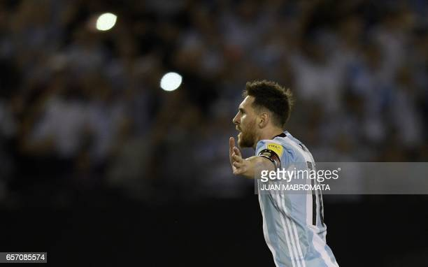 Argentina's forward Lionel Messi celebrates after scoring a penalty against Chile during a 2018 FIFA World Cup Russia South American qualifier...