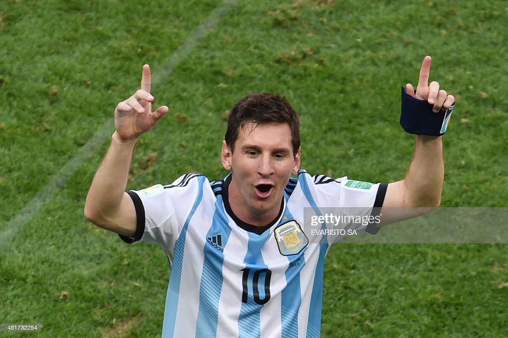 Argentina's forward Lionel Messi celebrates after winning a quarter-final football match between Argentina and Belgium at the Mane Garrincha National Stadium in Brasilia during the 2014 FIFA World Cup on July 5, 2014.