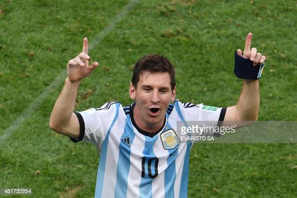 Argentina's forward Lionel Messi celebrates after winning a quarterfinal football match between Argentina and Belgium at the Mane Garrincha National...