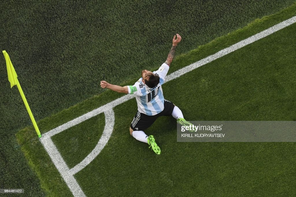 TOPSHOT - Argentina's forward Lionel Messi celebrates his goal during the Russia 2018 World Cup Group D football match between Nigeria and Argentina at the Saint Petersburg Stadium in Saint Petersburg on June 26, 2018. (Photo by Kirill KUDRYAVTSEV / AFP) / RESTRICTED