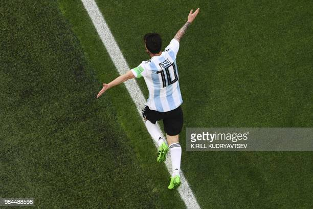 TOPSHOT Argentina's forward Lionel Messi celebrates his goal during the Russia 2018 World Cup Group D football match between Nigeria and Argentina at...
