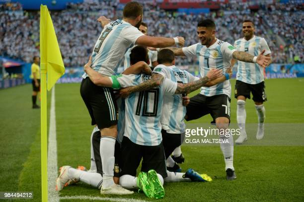 TOPSHOT Argentina's forward Lionel Messi celebrates his goal with teammates during the Russia 2018 World Cup Group D football match between Nigeria...