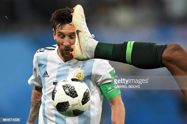 TOPSHOT Argentina's forward Lionel Messi competes for the ball during the Russia 2018 World Cup Group D football match between Nigeria and Argentina...