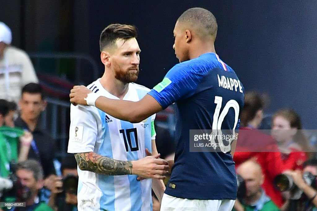 Argentina's forward Lionel Messi congratulates France's forward Kylian Mbappe (R) at the end of the Russia 2018 World Cup round of 16 football match between France and Argentina at the Kazan Arena in Kazan on June 30, 2018. (Photo by Luis Acosta / AFP) / RESTRICTED