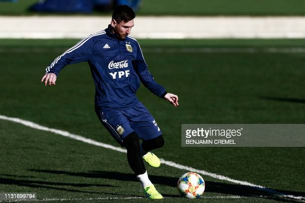 Argentina's forward Lionel Messi controls a ball during a training session at Real Madrid's training facilities of Valdebebas in Madrid on March 20...