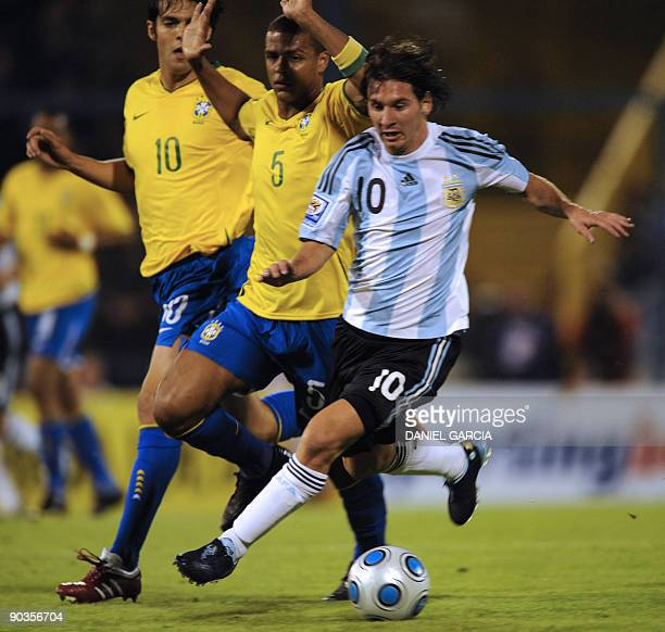 Argentina's forward Lionel Messi controls the ball followed by Brazilian Felipe Melo and Kaka during their FIFA World Cup South Africa 2010 qualifier...