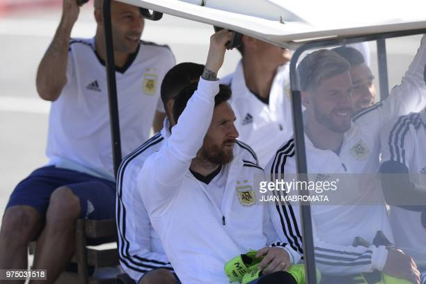 Argentina's forward Lionel Messi defender Cristian Ansaldi and midfielder Javier Mascherano arrive to a training session at the team's base camp in...