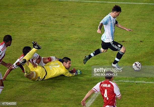 Argentina's forward Lionel Messi drives the ball past Paraguay's goalkeeper Antony Silva during their 2015 Copa America football championship match...