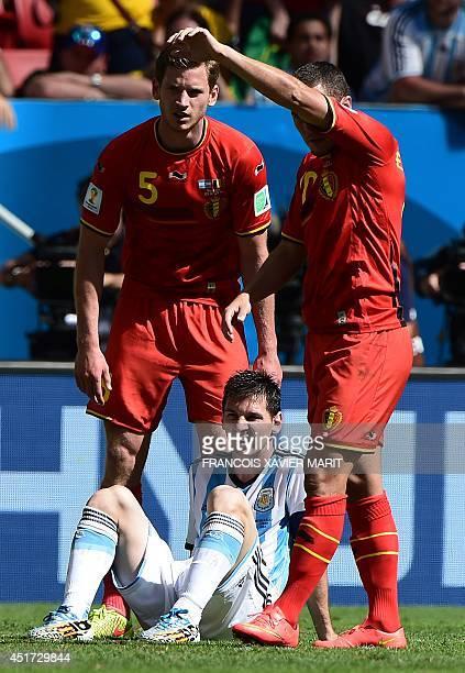 Argentina's forward Lionel Messi falls next to Belgium's defender Jan Vertonghen and Belgium's midfielder Eden Hazard during a quarterfinal football...