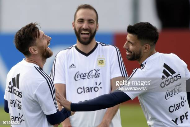 Argentina's forward Lionel Messi forward Gonzalo Higuain and forward Sergio Aguero laugh during a training session of Argentina's national football...