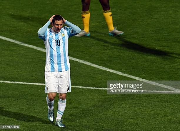 Argentina's forward Lionel Messi gestures after missing a shot during the 2015 Copa America football championship match in Vina del Mar on June 20...