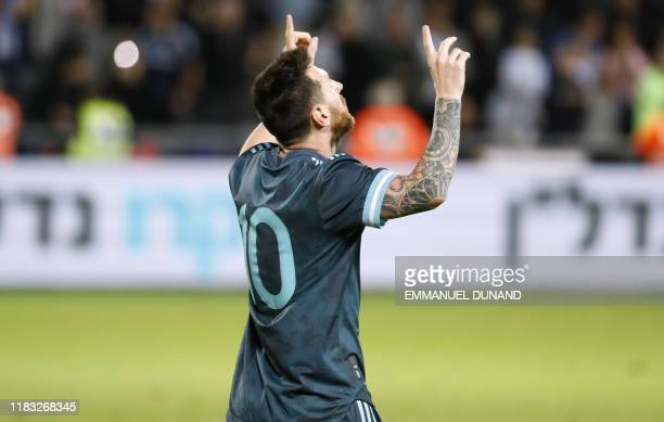 Argentina's forward Lionel Messi gestures after scoring during the friendly football match between Argentina and Uruguay at the Bloomfield stadium in...