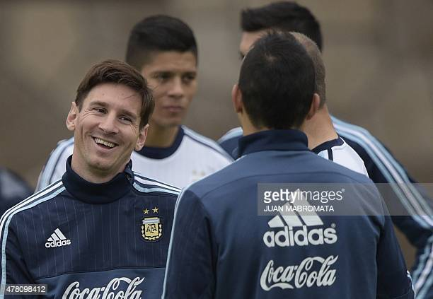 Argentina's forward Lionel Messi gestures next to teammates during a training session in La Serena Coquimbo Chile on June 22 2015 ahead of ther Copa...
