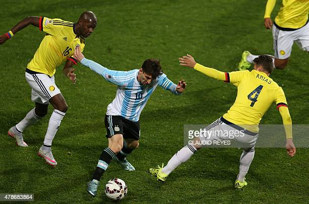 Argentina's forward Lionel Messi is marked by Colombia's forward Victor Ibarbo and defender Santiago Arias during the 2015 Copa America football...