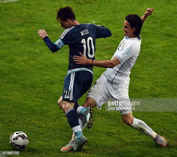 Argentina's forward Lionel Messi is marked by Uruguay's forward Edinson Cavani during their 2015 Copa America football championship match in La...