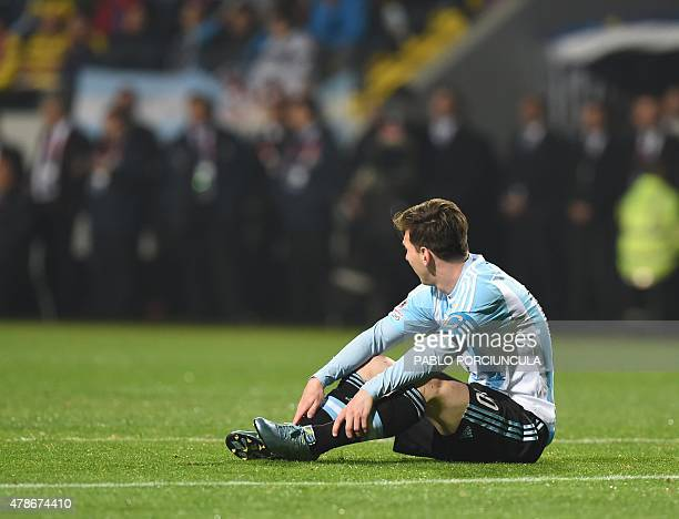 Argentina's forward Lionel Messi is seen on the ground during the 2015 Copa America football championship quarterfinal match against Colombia in Vina...