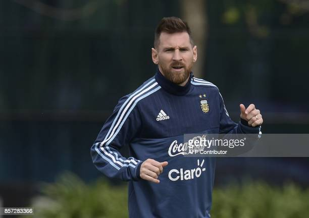 Argentina's forward Lionel Messi jogs during a training session in Ezeiza Buenos Aires on October 3 2017 ahead of a 2018 FIFA World Cup South...