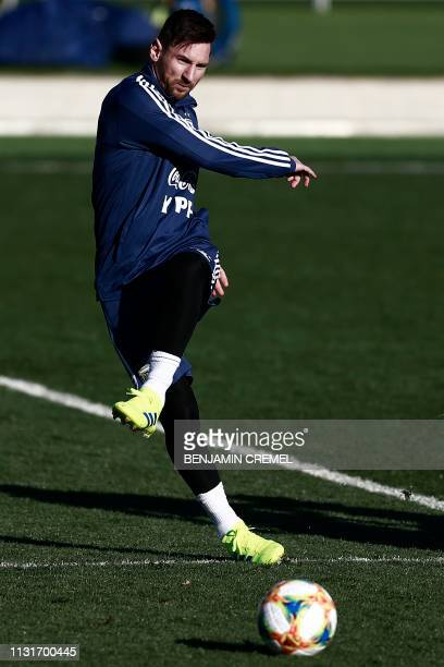 Argentina's forward Lionel Messi kicks a ball during a training session at Real Madrid's training facilities of Valdebebas in Madrid on March 20...