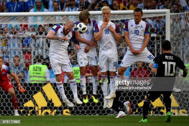 TOPSHOT Argentina's forward Lionel Messi kicks a free kick during the Russia 2018 World Cup Group D football match between Argentina and Iceland at...