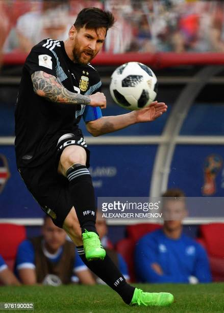 Argentina's forward Lionel Messi kicks a free kick during the Russia 2018 World Cup Group D football match between Argentina and Iceland at the...