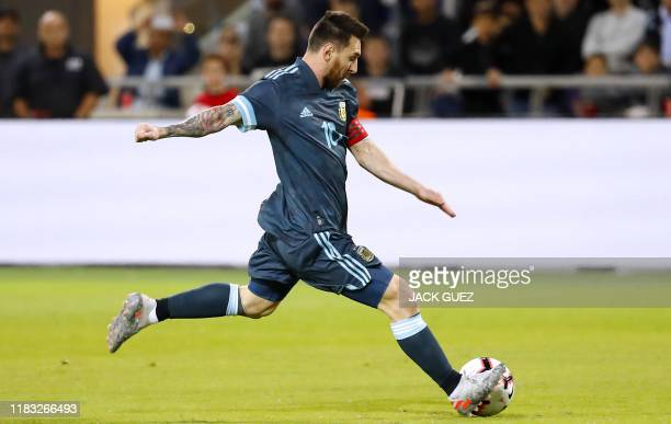 Argentina's forward Lionel Messi kicks the ball during the friendly football match between Argentina and Uruguay at the Bloomfield stadium in the...