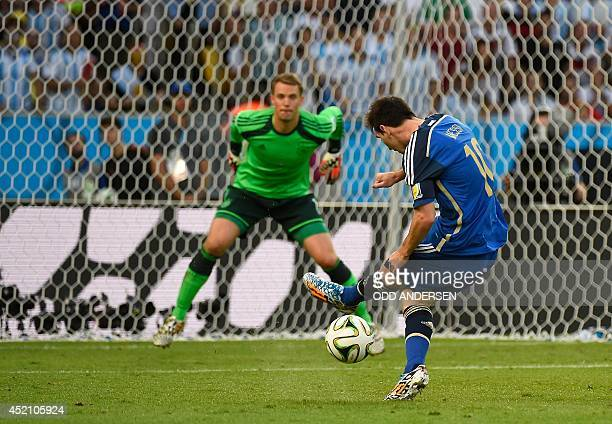 Argentina's forward Lionel Messi kicks the ball in front of Germany's goalkeeper Manuel Neuer during the final football match between Germany and...