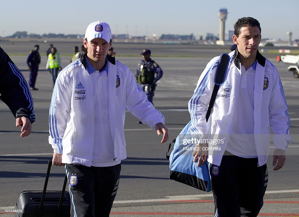Argentina's forward Lionel Messi (L) leaves his plane with teammate midfielder Maxi Rodriguez upon their team's arrival at O. R. Tambo international airport on May 29, 2010 in Johannesburg ahead of the 2010 FIFA World Cup in South Africa. Argentina will play their first match against Nigeria on June 12.