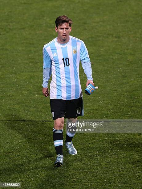 Argentina's forward Lionel Messi leaves the pitch at the end of the first half during their 2015 Copa America football championship quarterfinal...
