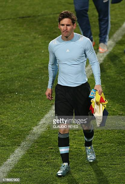 Argentina's forward Lionel Messi leaves the pitch at the end of their 2015 Copa America football championship quarterfinal match against Colombia in...