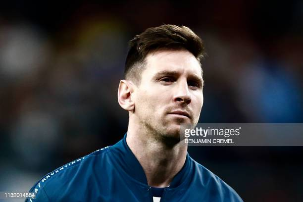 Argentina's forward Lionel Messi listens to the national anthems ahead an international friendly football match between Argentina and Venezuela at...