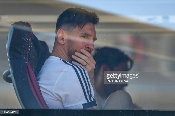 TOPSHOT Argentina's forward Lionel Messi looks on from a bus as Argentina's national football team arrives at El Prat airport in Barcelona on May 31...