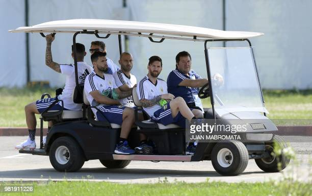 Argentina's forward Lionel Messi midfielder Javier Mascherano forward Sergio Aguero and midfielder Ever Banega arrive a training session at the...
