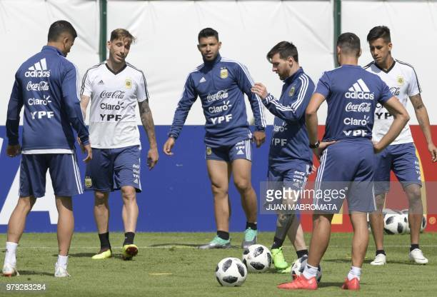 Argentina's forward Lionel Messi passes the ball to teammates during training session at the team's base camp in Bronnitsy near Moscow Russia on June...