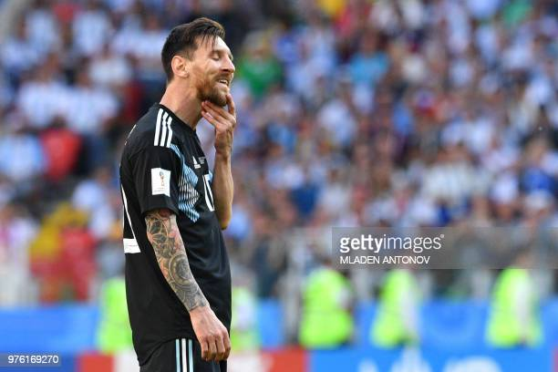 TOPSHOT Argentina's forward Lionel Messi reacts after his penalty was saved during the Russia 2018 World Cup Group D football match between Argentina...