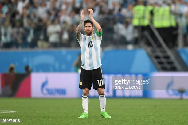 TOPSHOT Argentina's forward Lionel Messi reacts after victory during the Russia 2018 World Cup Group D football match between Nigeria and Argentina...