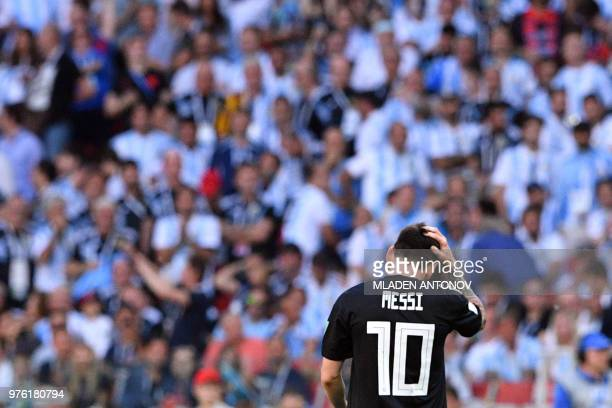 Argentina's forward Lionel Messi reacts at the end of the Russia 2018 World Cup Group D football match between Argentina and Iceland at the Spartak...