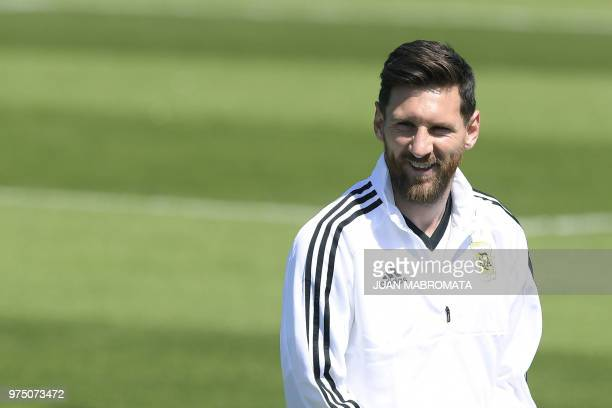 Argentina's forward Lionel Messi reacts during a training session of the Argentina's national football team at the team's base camp in Bronnitsy near...