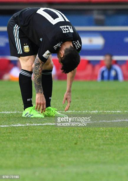 Argentina's forward Lionel Messi reacts during the Russia 2018 World Cup Group D football match between Argentina and Iceland at the Spartak Stadium...