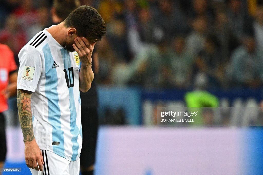 TOPSHOT - Argentina's forward Lionel Messi reacts during the Russia 2018 World Cup Group D football match between Argentina and Croatia at the Nizhny Novgorod Stadium in Nizhny Novgorod on June 21, 2018. (Photo by Johannes EISELE / AFP) / RESTRICTED