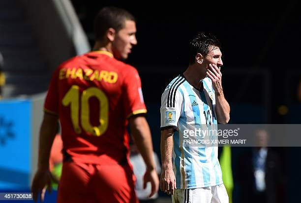 Argentina's forward Lionel Messi reacts in front of Belgium's midfielder Eden Hazard during the second half of a quarterfinal football match between...