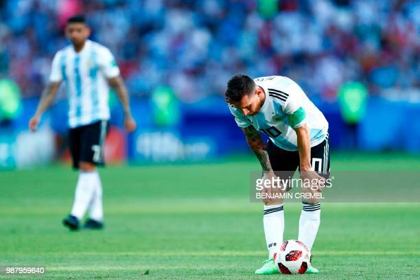 Argentina's forward Lionel Messi reacts to France's fourth goal during the Russia 2018 World Cup round of 16 football match between France and...