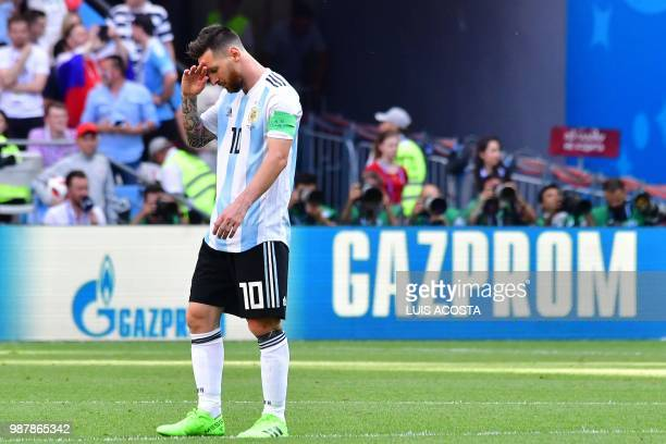Argentina's forward Lionel Messi reacts to France's opener during the Russia 2018 World Cup round of 16 football match between France and Argentina...